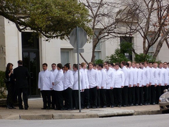 Waiters waiting in line for an outdoor celebration